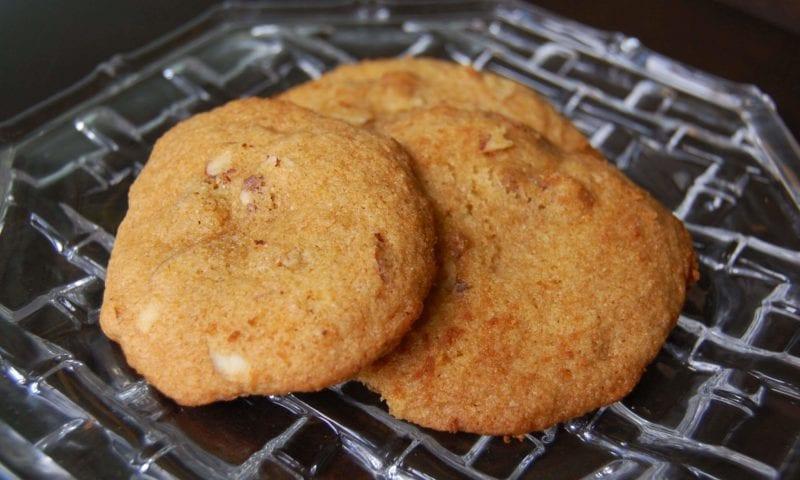 Three honey nut cookies on a plate.