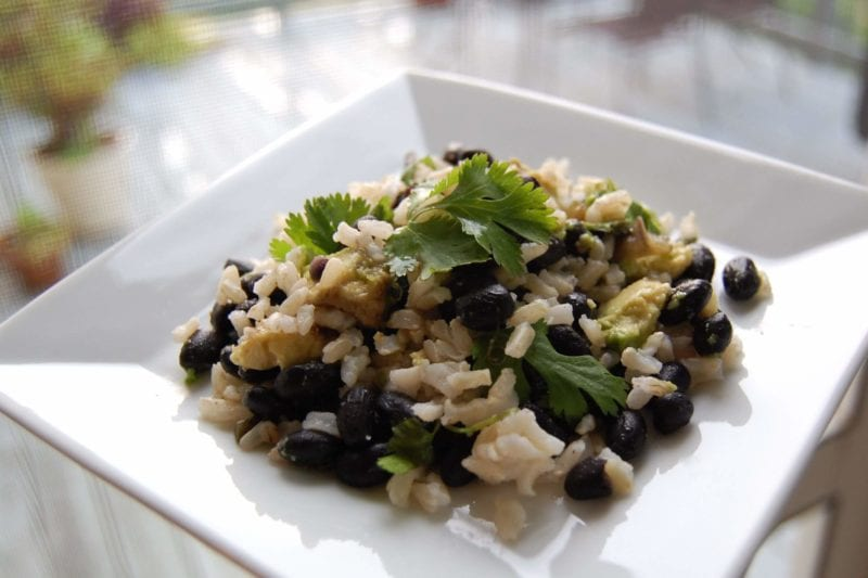 Black beans and rice on a plate.