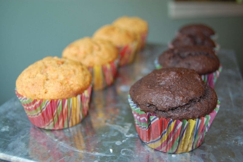 Two rows of chocolate and carrot cupcakes with no frosting.