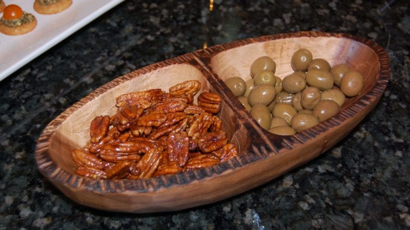 Candied pecans and ostatu rioja blanco in a serving tray.