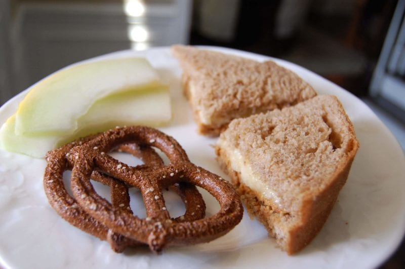 Peanut butter and banana (instead of jelly) sandwich, whole-wheat pretzels, and fruit.