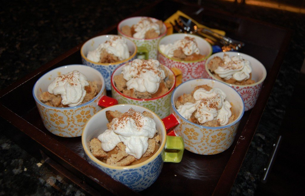 Homemade South Carolina peach sorbet topped with honey vanilla cookie crumble and whipped cream in mugs.