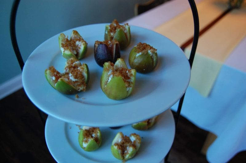 Goat cheese stuffed figs on a serving tray.