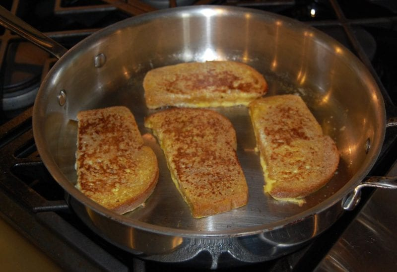 Homemade french toast cooking on the stove.