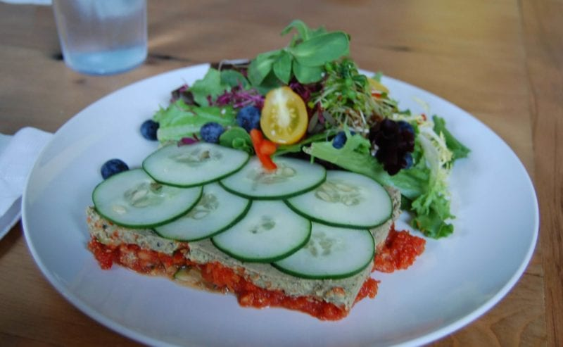 Vegan lasagne served with cucumbers and a side salad at Luna's Living Kitchen in Charlotte, NC.