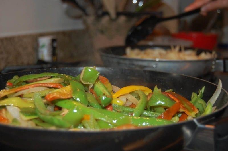 Veggies for fajitas cooking on the stove.