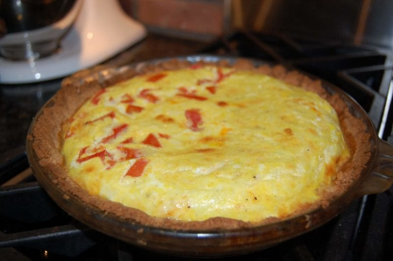 Homemade quiche with a whole-wheat crust.