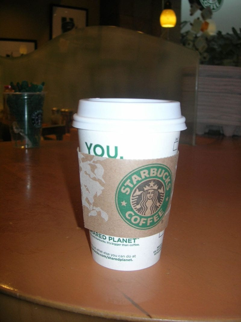 Starbucks coffee cup on a table.
