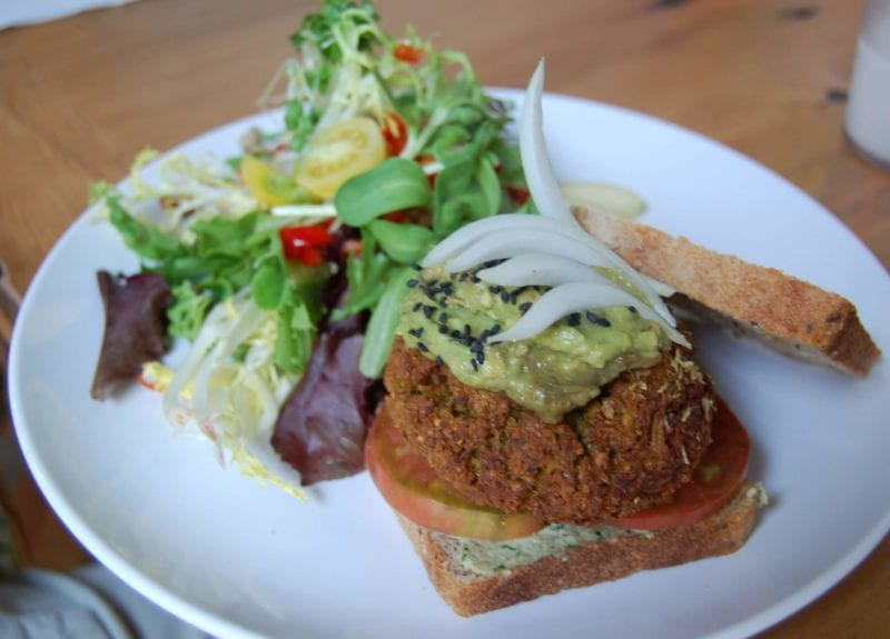 Veggie burger on whole-grain bread with a side salad from Luna's Living Kitchen in Charlotte, NC.
