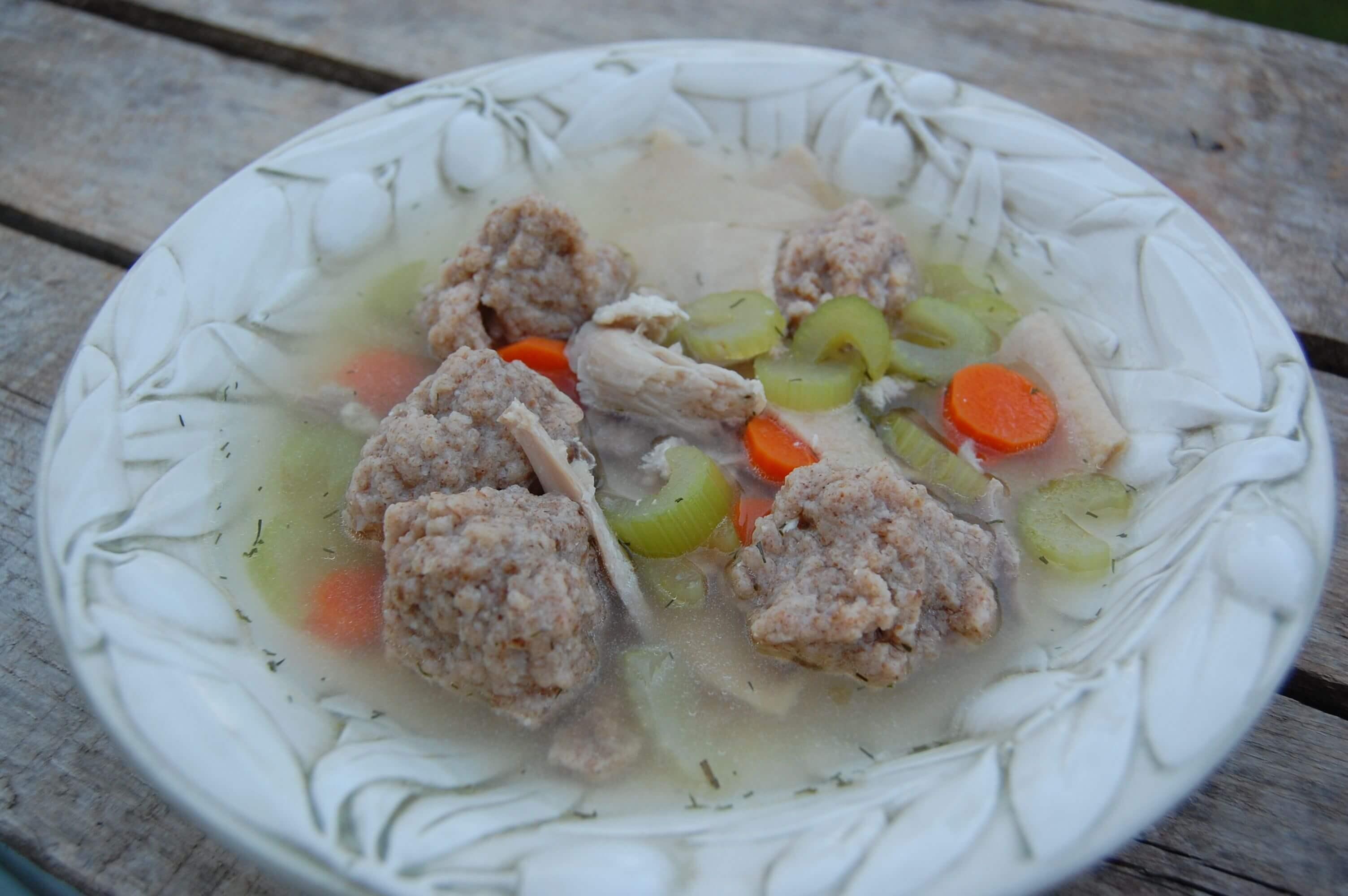 Homemade matzo ball soup in a bowl.