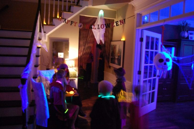Inside of a house that is decorated for Halloween.