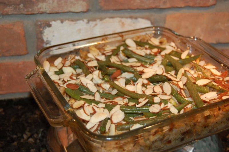 Homemade chicken casserole with green beans and almonds on top.