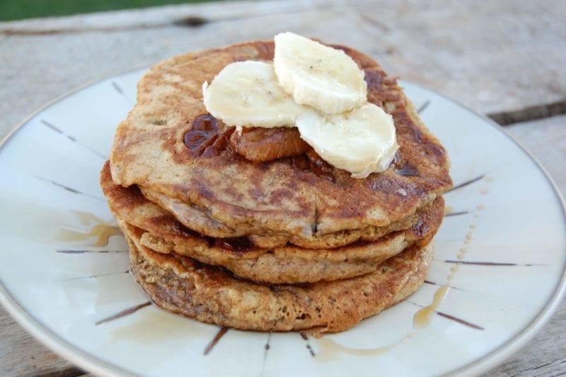 Homemade whole-wheat banana pancakes on a plate.