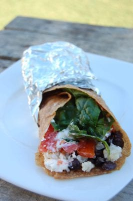 Pork, rice, black bean, and spinach burritos wrapped in whole-wheat tortillas.
