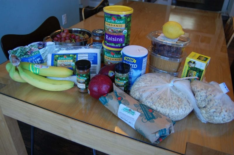 Groceries from Earth Fare that include produce, raisins, frozen blueberries, peanut butter, nuts, fresh flounder, and more.