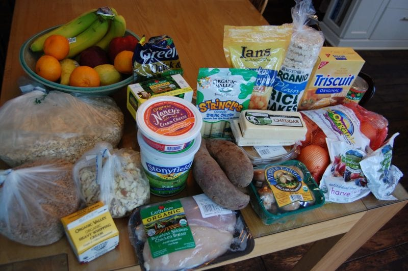 Groceries from Earth Fare that include produce, chicken, oats, cheese, crackers, and more.