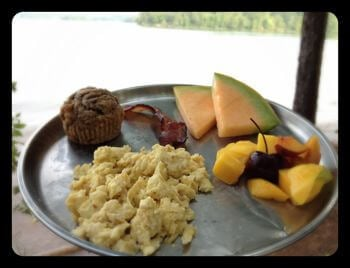 Camping Breakfast: Scrambled Eggs, Whole-Wheat Banana Nut Muffin, Bacon, and Fruit