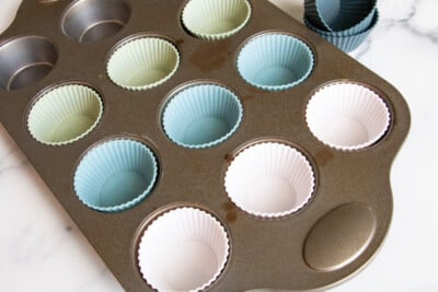 silicone muffins cups in a muffin pan.