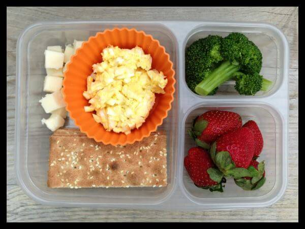 Leftover egg salad, whole-wheat (ak-mak crackers), cheese cubes, strawberries, and leftover cooked broccoli