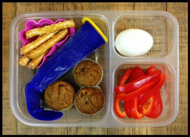 Red bell pepper slices, hard-boiled egg, 3 mini whole-grain pumpkin muffins, frozen smoothie pop (made with berries/bananas/plain yogurt/swiss chard leaves), and some whole-wheat pretzels (from Trader Joe's)