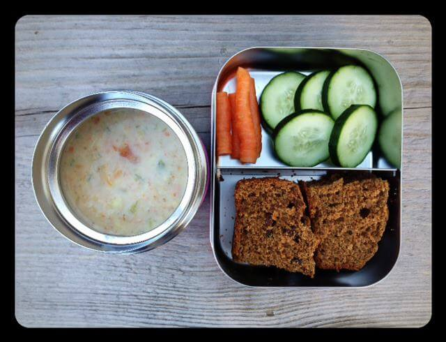 Leftover veggie corn chowder (warm in thermos), whole-wheat cinnamon raisin bread, and cucumbers/carrots