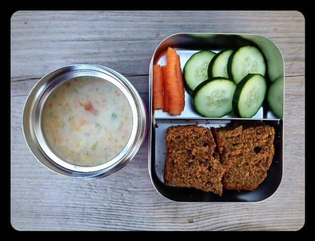 Leftover veggie corn chowder (warm in thermos), whole-wheat cinnamon raisin bread, and cucumbers/carrots