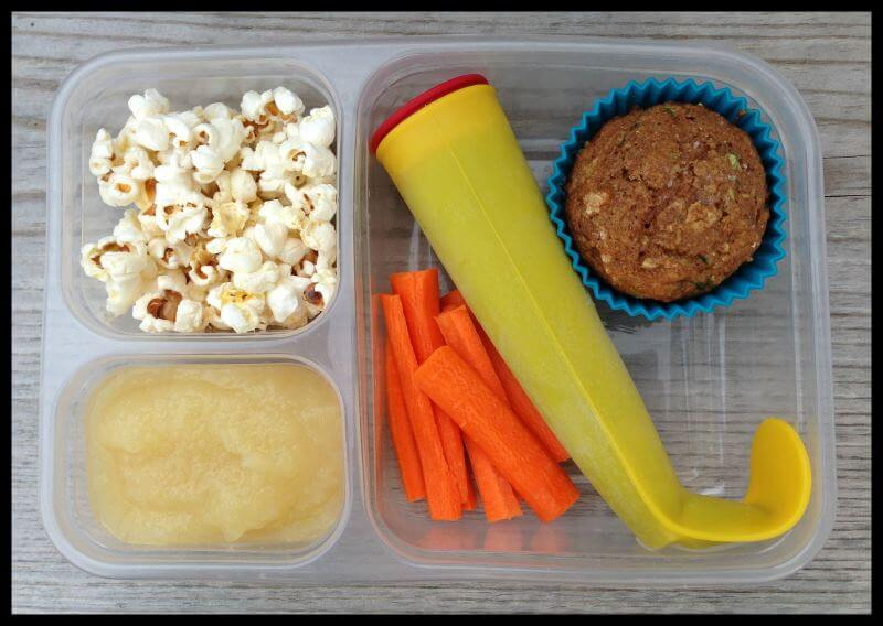Popcorn, applesauce, carrots, berry/yogurt/spinach/banana smoothie pop, and a whole-grain zucchini muffin