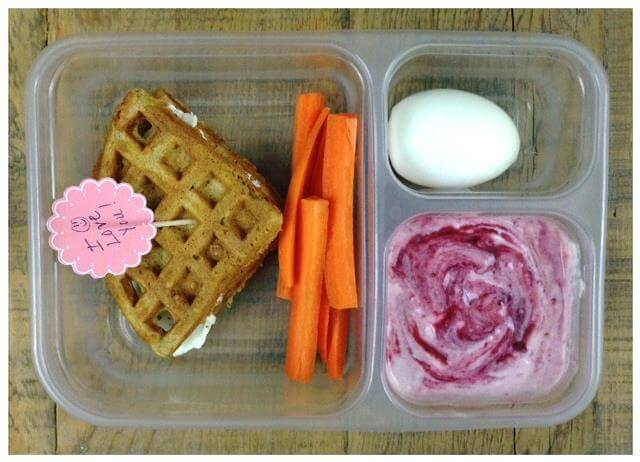 Whole-wheat waffle/cream cheese/cinnamon sandwich, carrots, plain yogurt mixed with homemade berry sauce, and a hard-boiled egg