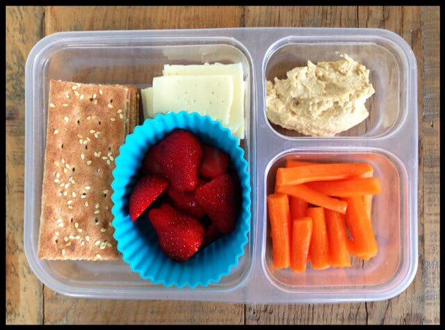 Whole-grain (ak-mak brand) crackers, havarti cheese slices, strawberries, carrots, and hummus (for dipping)
