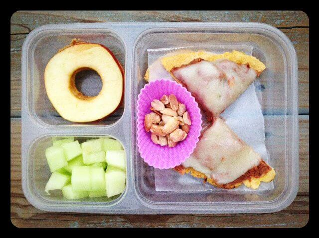 Refried bean/cheese tostada (cut into 4 triangles and served cold), peanuts, honey dew melon, and an apple/sunflower butter sandwich