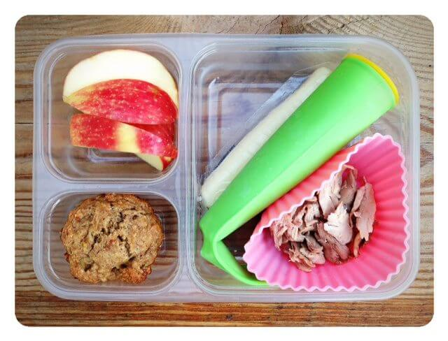 Leftover roasted chicken, berry/yogurt/spinach frozen smoothie pop, cheese stick, apple slices, and a whole-wheat banana nut muffin