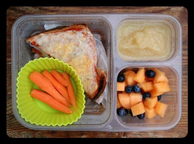 Sandwich bread pizza (tomato sauce and cheese on top of regular sandwich bread and toasted), melon/blueberries, applesauce, and carrots