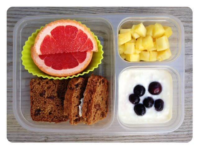 Whole-wheat cinnamon raisin bread/cream cheese sandwich, grapefruit slices, pineapple bits, and plain yogurt mixed with a little vanilla extract, pure maple syrup and frozen blueberries
