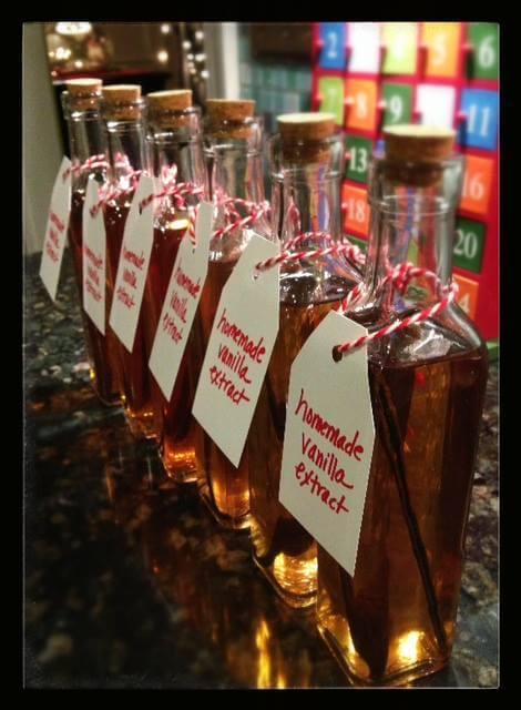 Homemade Vanilla Extract on 100 Days of Real Food - bottles with tags