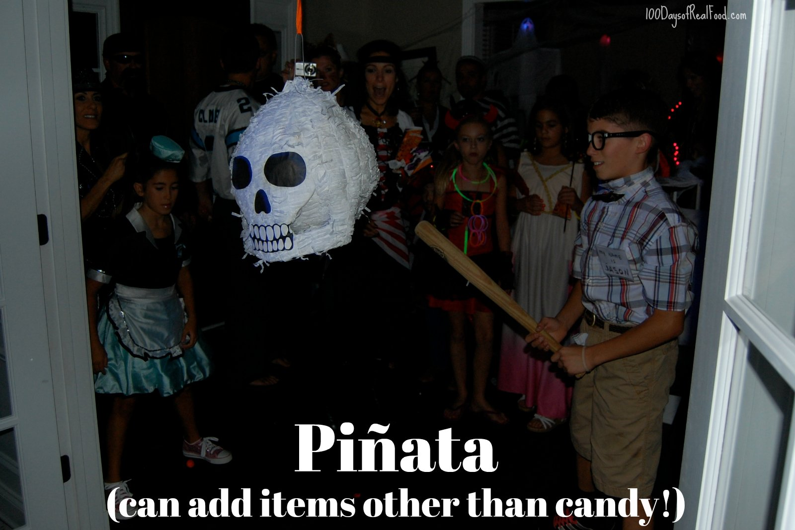 Skull pinata about to be hit