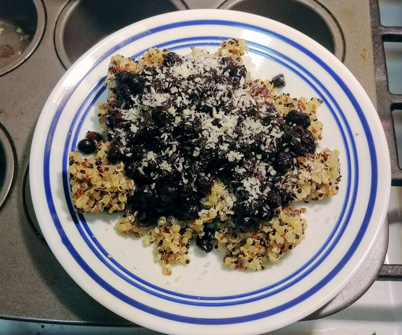 Vanilla quinoa with homemade blueberry sauce and shredded coconut