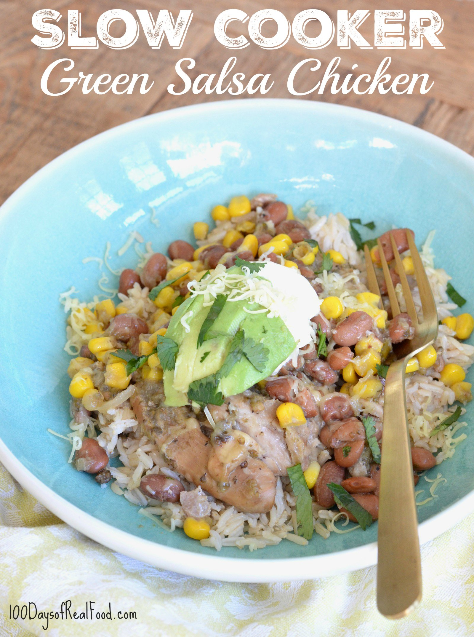 Slow Cooker Green Salsa Chicken in blue bowl on a table.