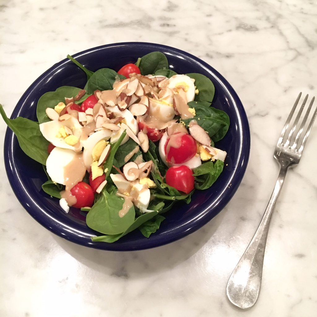 Food Diary:Salad with spinach, hard boiled eggs, tomatoes, almond slivers and a tahini dressing.