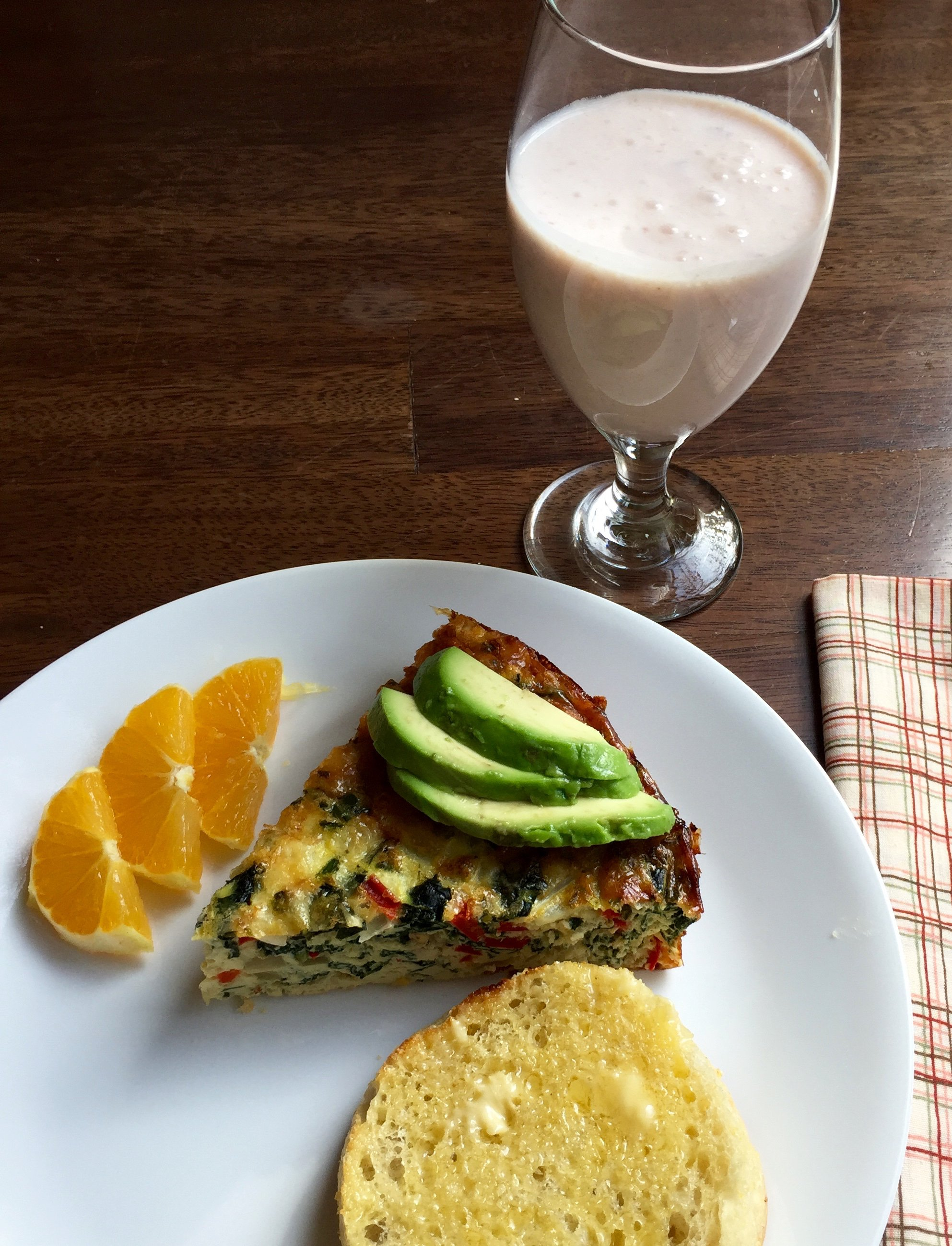 frittata (eggs, milk, onions, bell and poblano peppers, kale, gruyere, cheddar) with avocado