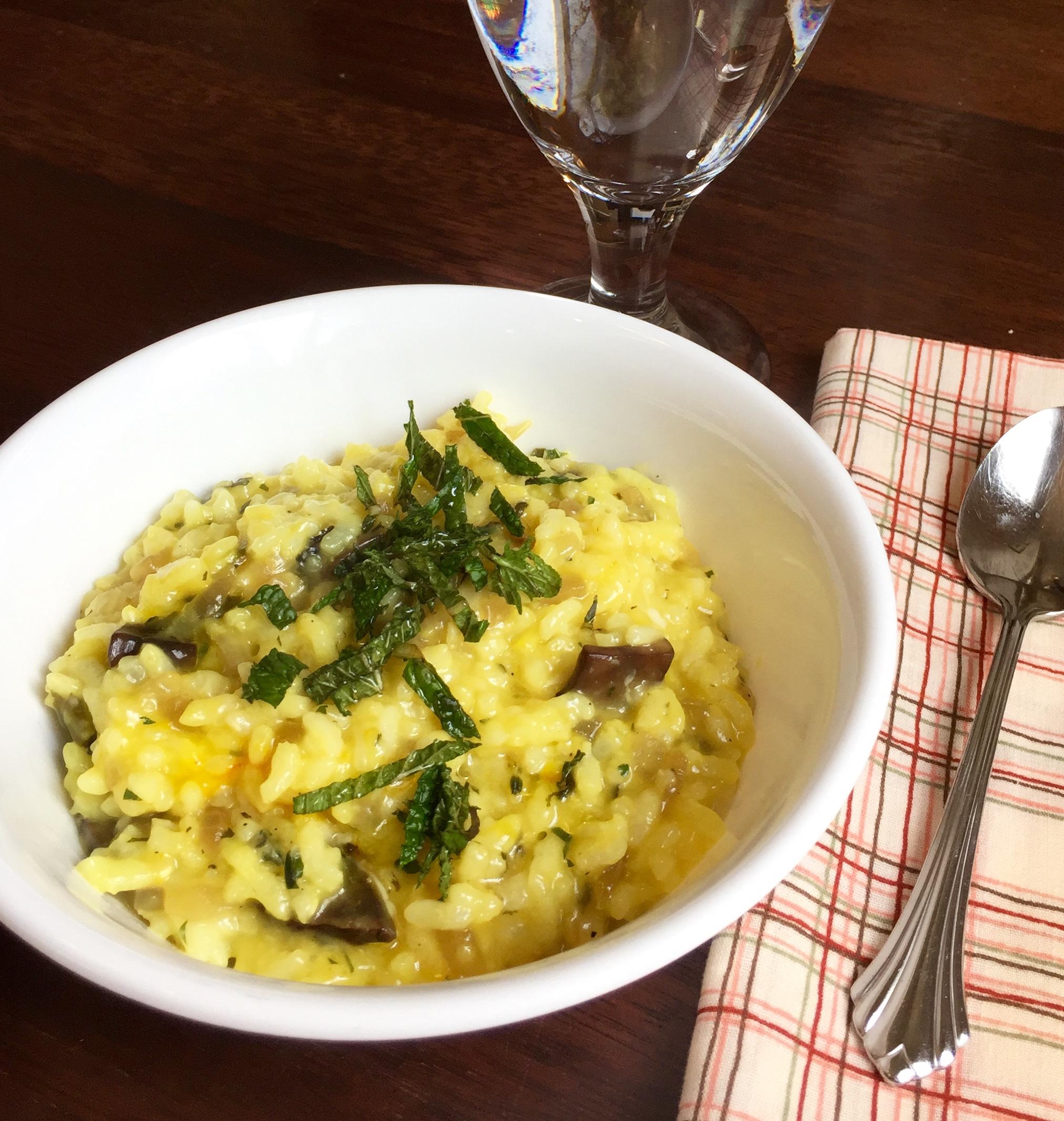 risotto with portobello, onions, pecorino, parmigiano reggiano, saffron, thyme, French sorrel, mint