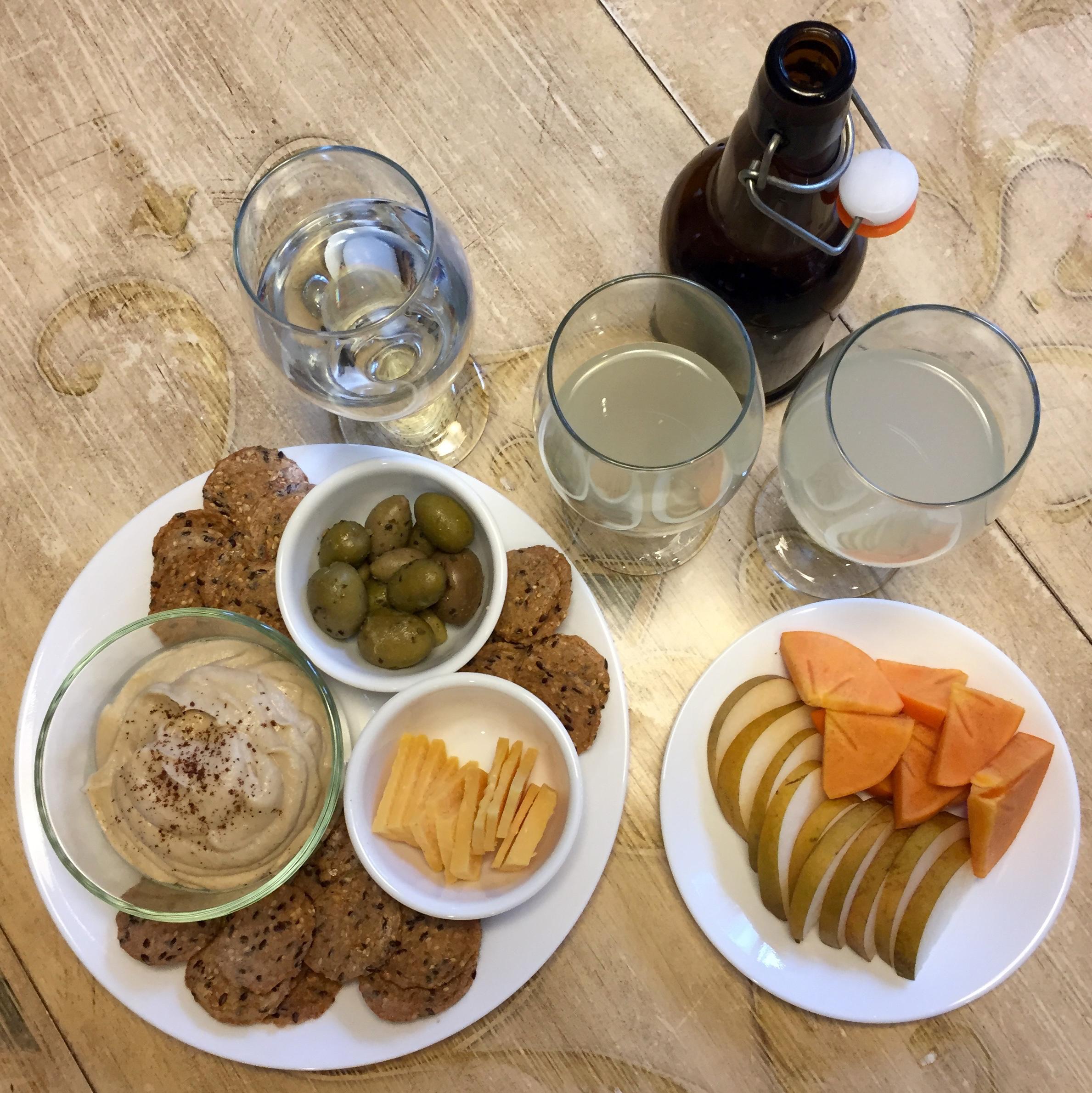 hummus, gouda, olives, crackers, asian pear, persimmon