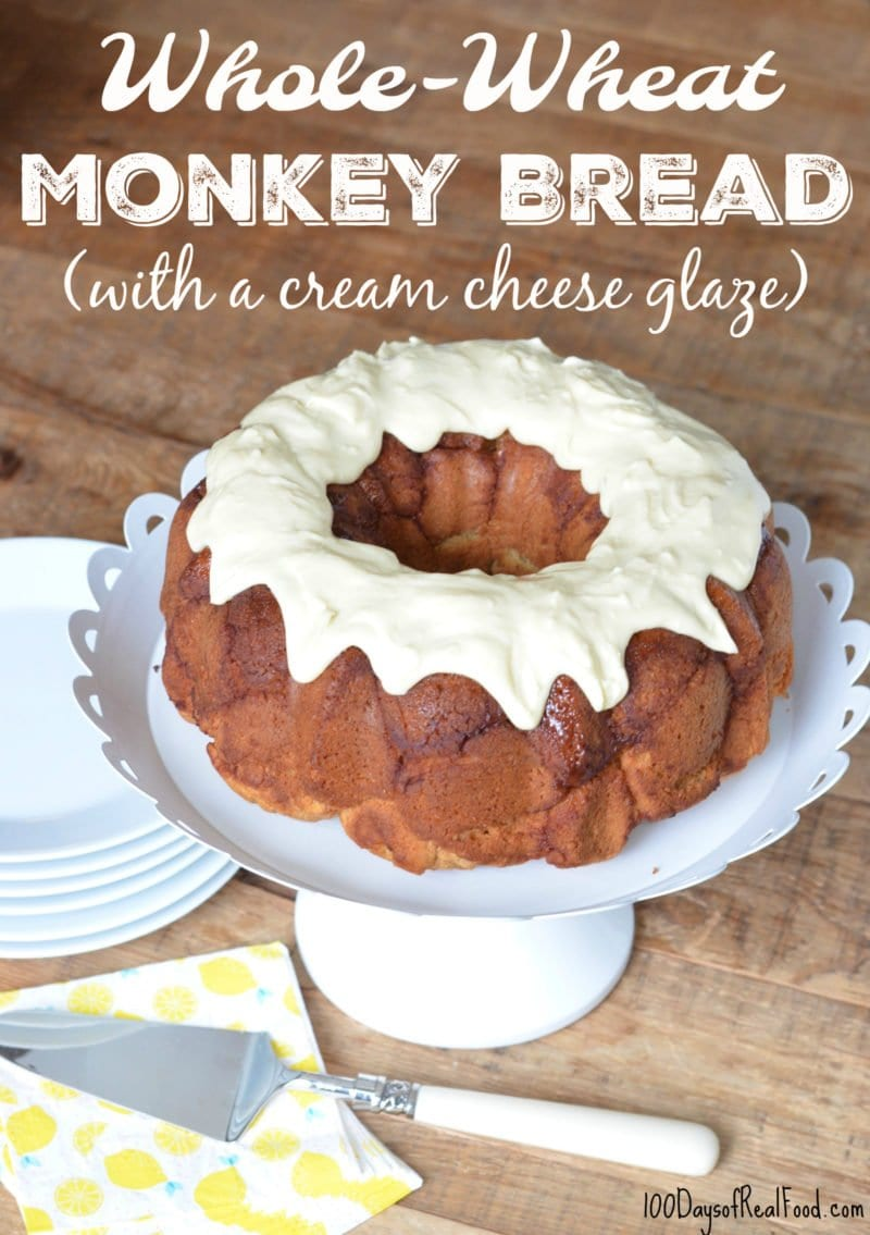 Whole Wheat Monkey Bread on cake stand with serving utensil