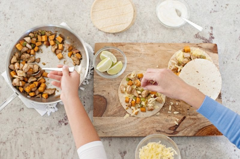 people who avoid processed food make dinners from scratch like these people assembling quesadillas
