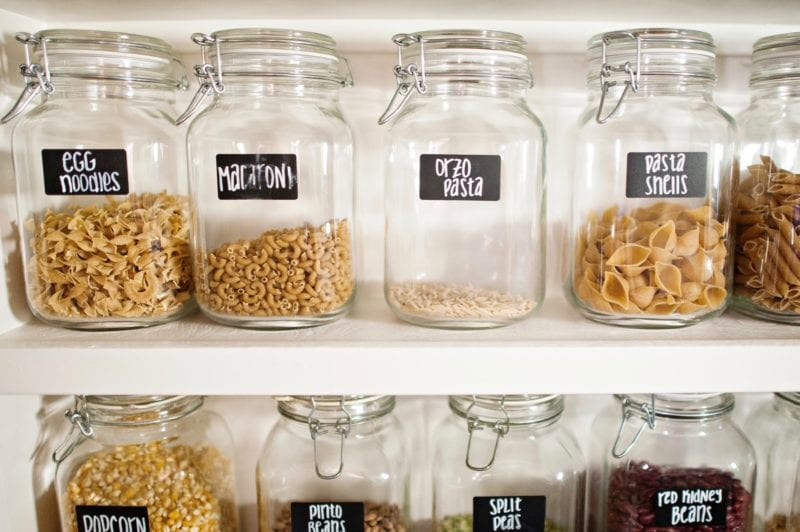 people who avoid processed food eat whole grains like the ones here in storage jars of pasta, grains, beans and popcorn
