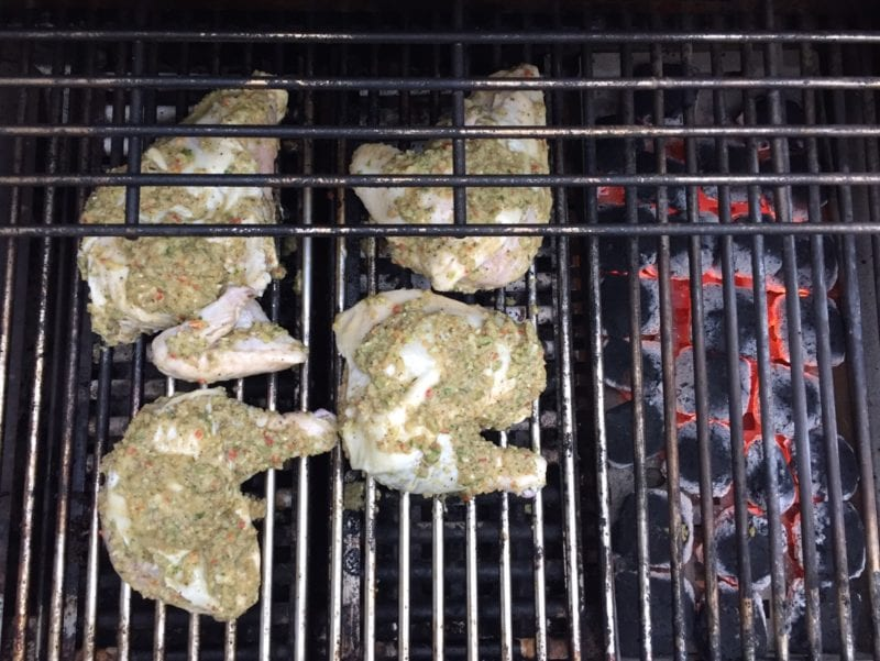Jerk Chicken cooking on charcoal grill on 100 Days of Real Food