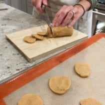 photo of Lisa cutting cookie dough for homemade Nilla Wafers on 100 Days of Real Food