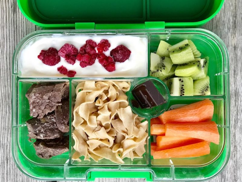 Leftover meat, Whole wheat egg noodles, Plain yogurt mixed with maple syrup and frozen raspberries, Kiwi, Carrots, Dark chocolate - School Lunch Roundup 12 on 100 Days of Real Food