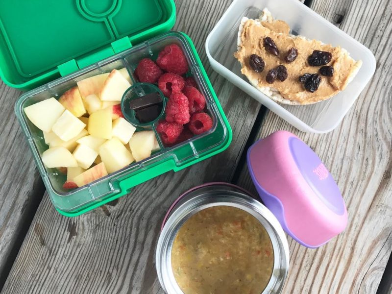 Veggie corn chowder, Brown rice cake with peanut butter and raisins, Apple and cheddar cubes, Raspberries, Dark chocolate - School Lunch Roundup 12 on 100 Days of Real Food