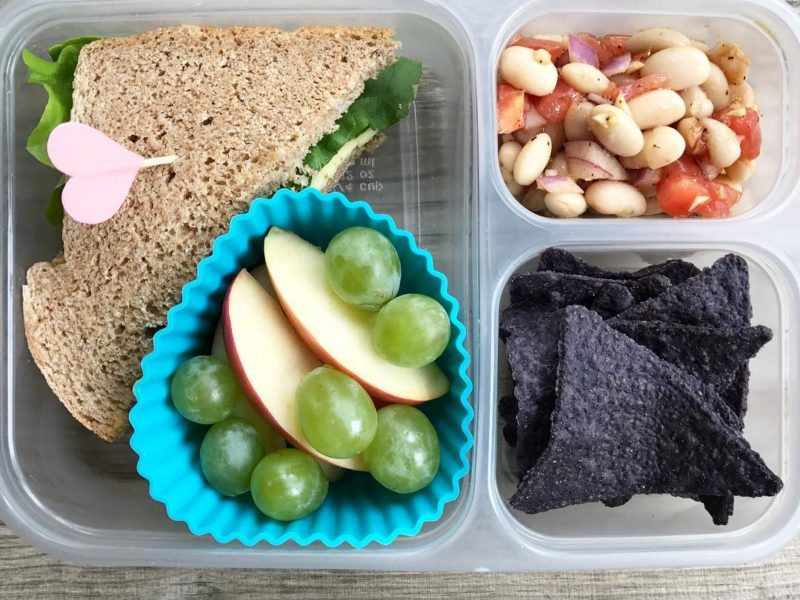 Red pepper hummus, cheese, and lettuce sandwich on whole wheat, Grapes, Apples, Homemade white bean dip, Blue tortilla chips - School Lunch Roundup 12 on 100 Days of Real Food