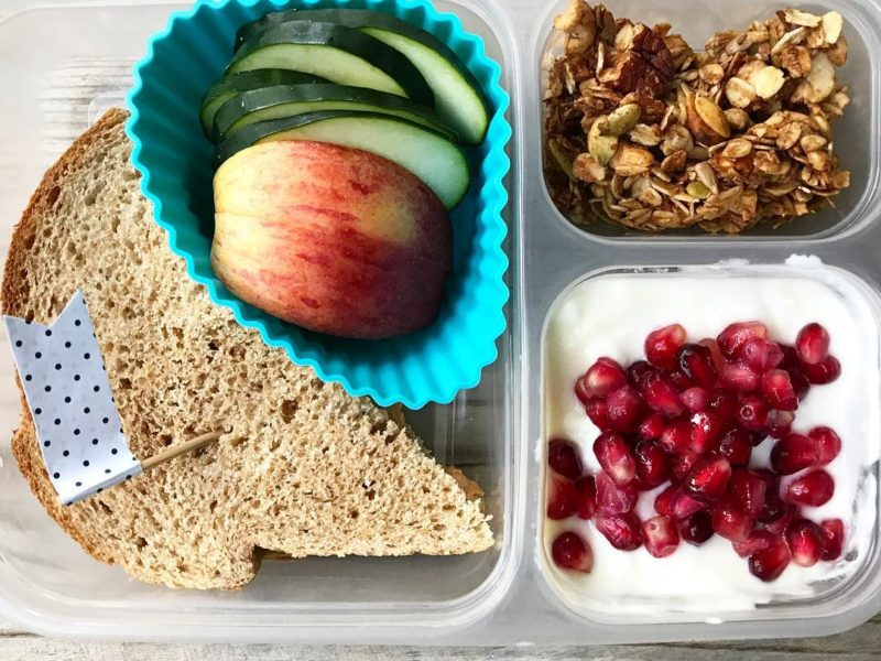 Peanut butter and honey on whole wheat, Apples, Cucumbers, Plain yogurt with maple syrup and pomegranate seeds, Homemade granola - School Lunch Roundup 12 on 100 Days of Real Food